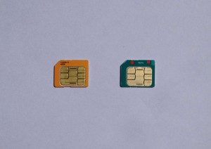 On the left is an AT&T SIM card, and on the right is a Kolbi SIM card.
